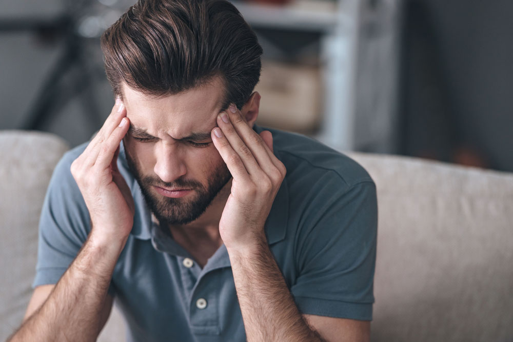 Man with headaches needs chiropractic care in Glen Carbon, Illinois.