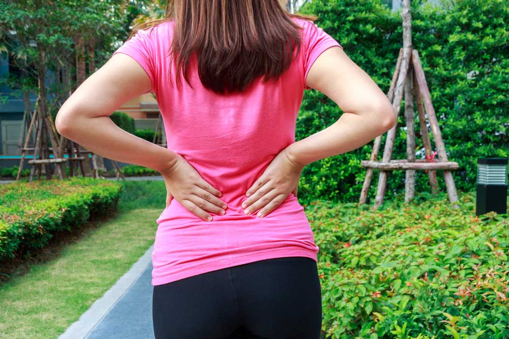 Woman with lower back pain needs chiropractic care.