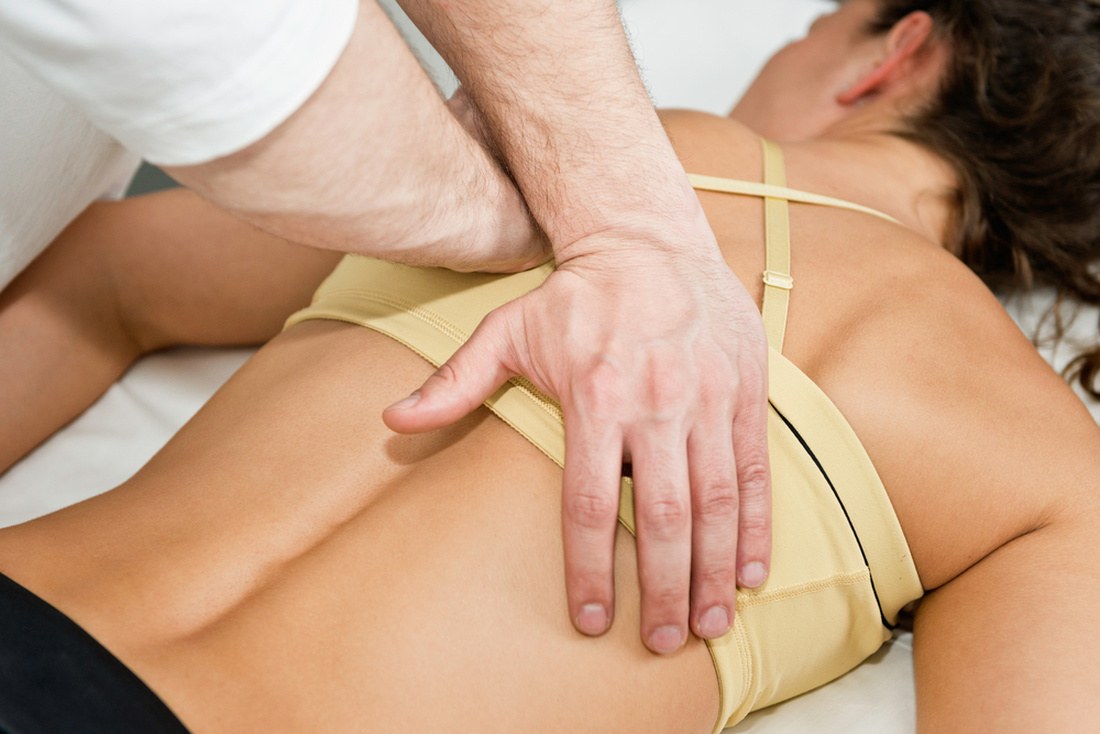 Woman getting Massage Therapy in Highland, and Carlyle, IL.