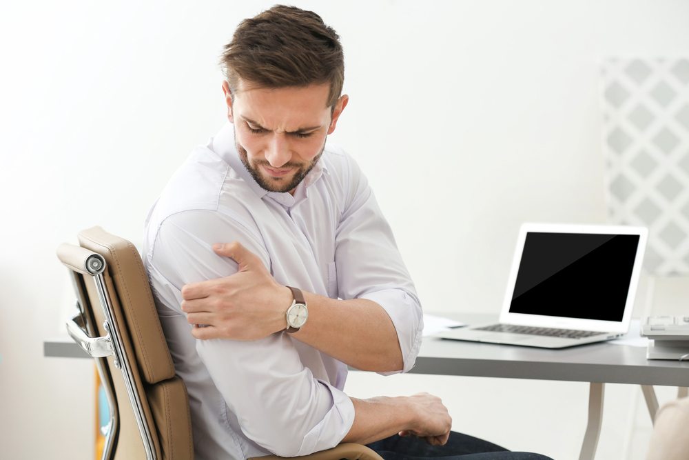 office worker hurting himself at work