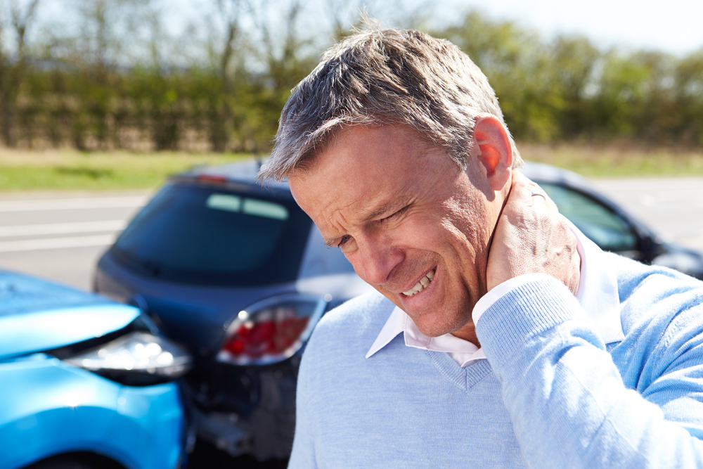 Man with whiplash needs chiropractic care in Glen Carbon.